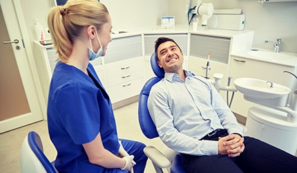 man smiling at his dentist