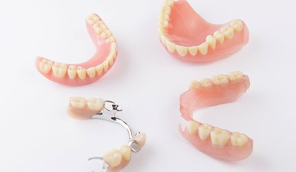 full and partial dentures sitting on a countertop